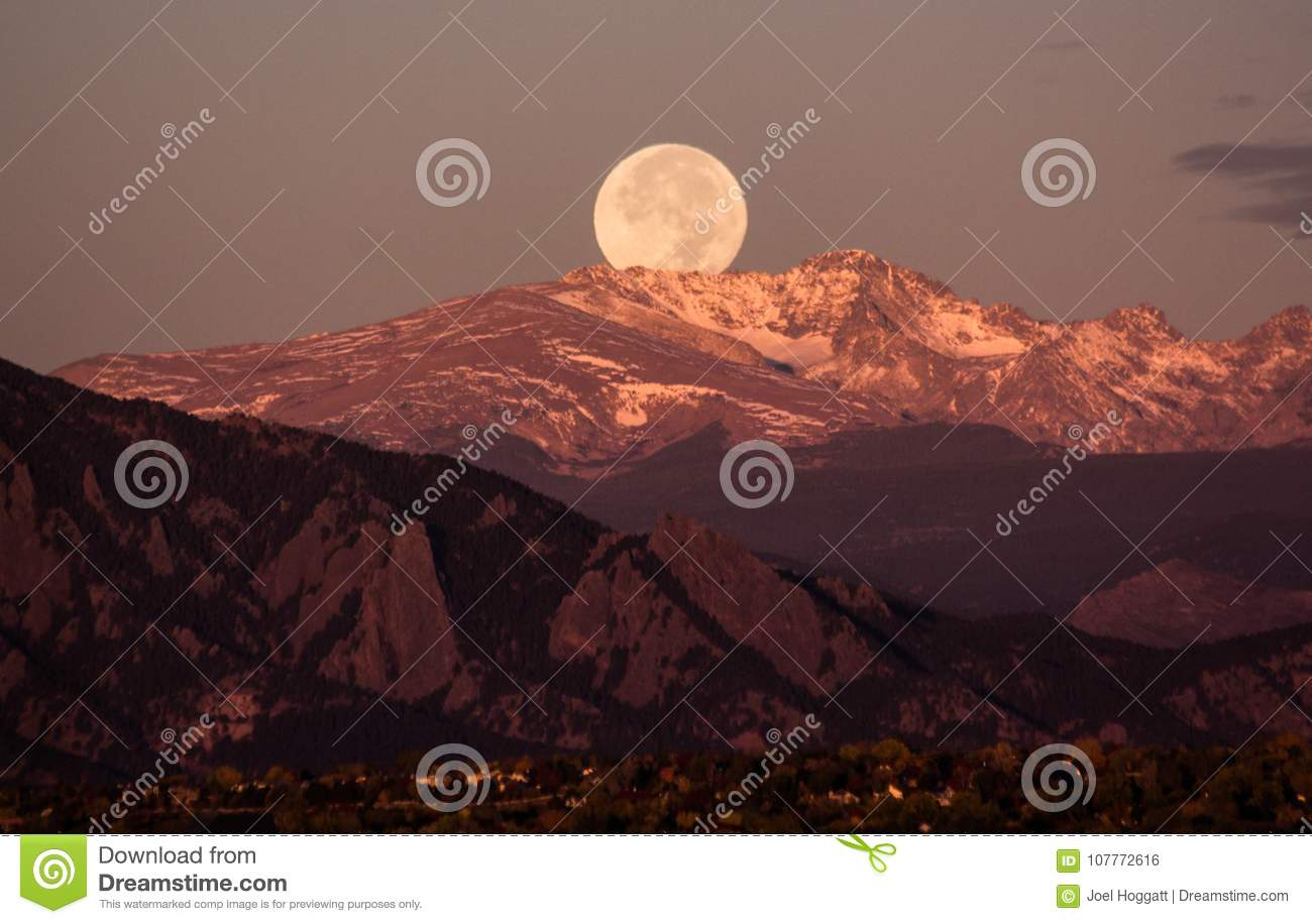 Moonset over the rocky mountains, behind Boulder Colorado