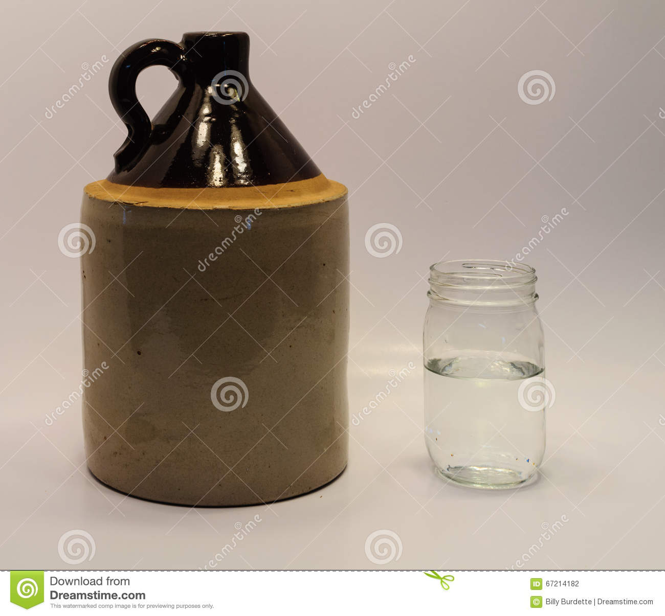 Moonshine Jug And Mason Jar Stock Photo - Image: 67214182