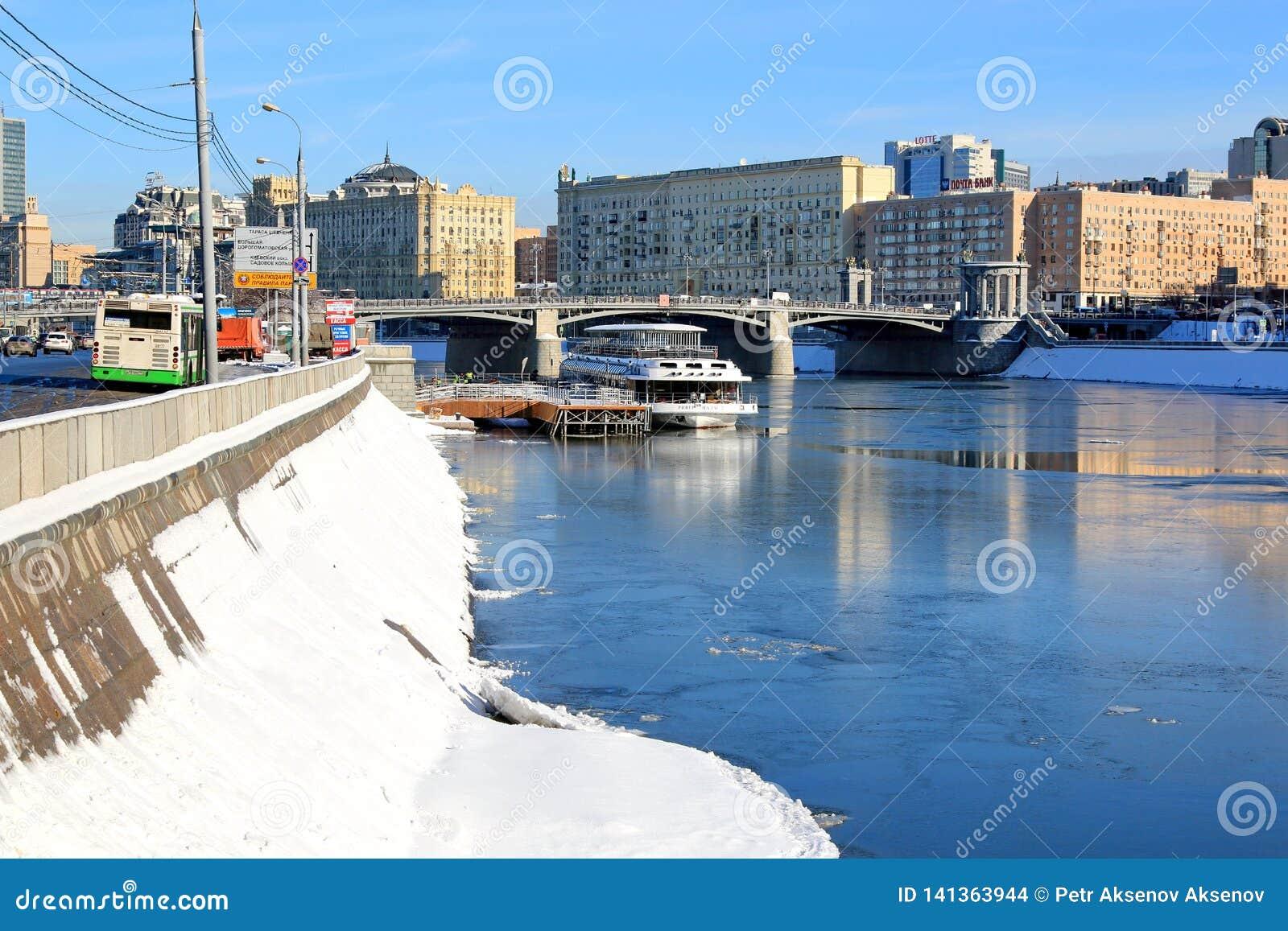 Moscow, Russia - February 14, 2019: Berezhkovskaya Embankment, a pier on the Moskva River and Borodinsky Bridge