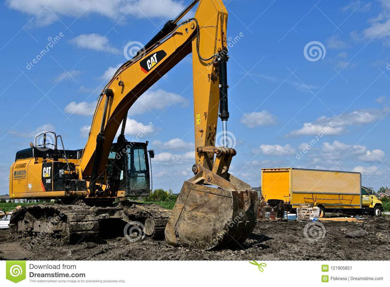 Caterpillar 349E Backhoe Parked In Mud Editorial Photo