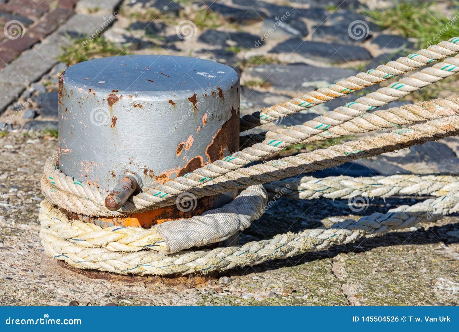 Mooring rope coiled around a bollard