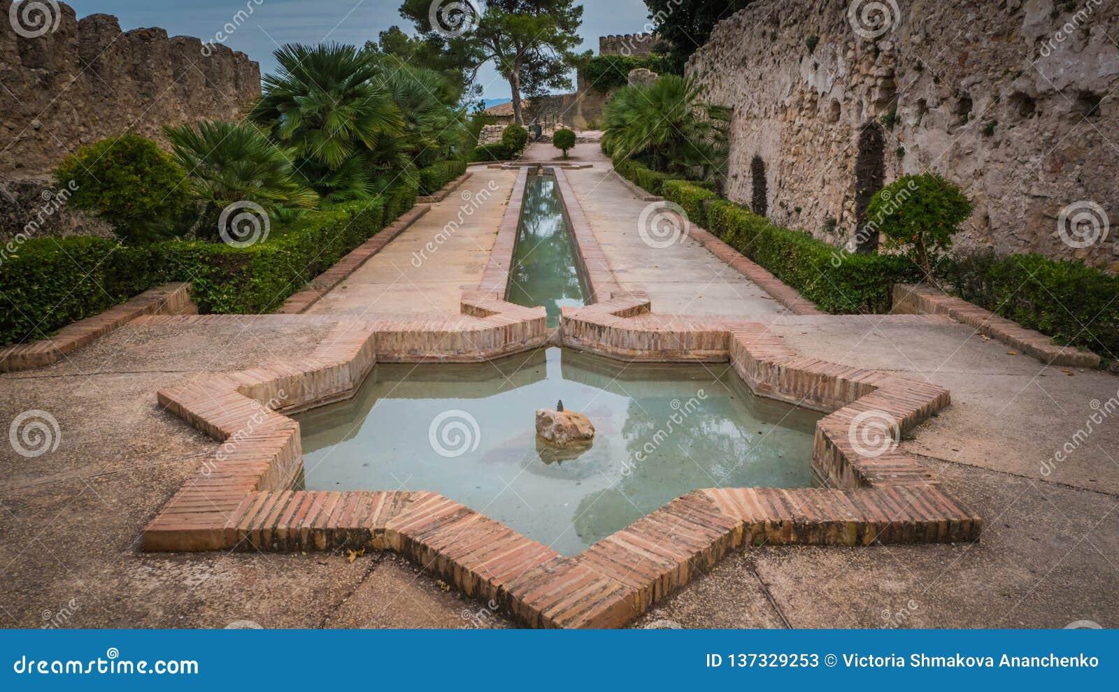 Moorish star shape fountain at Jativa medieval castles in Valencia Spain