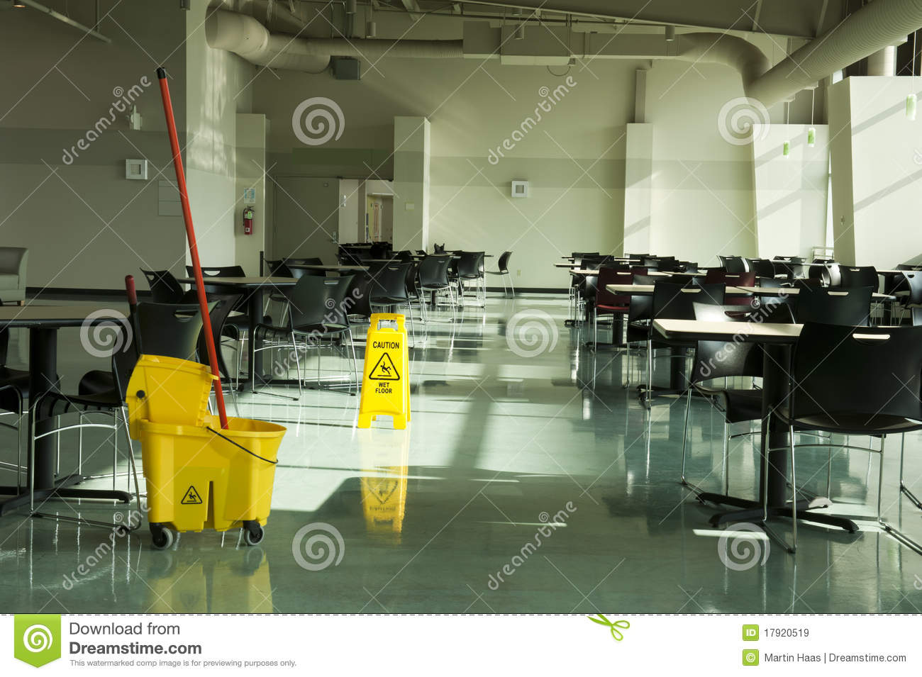 Mop bucket caution sign cafe tables