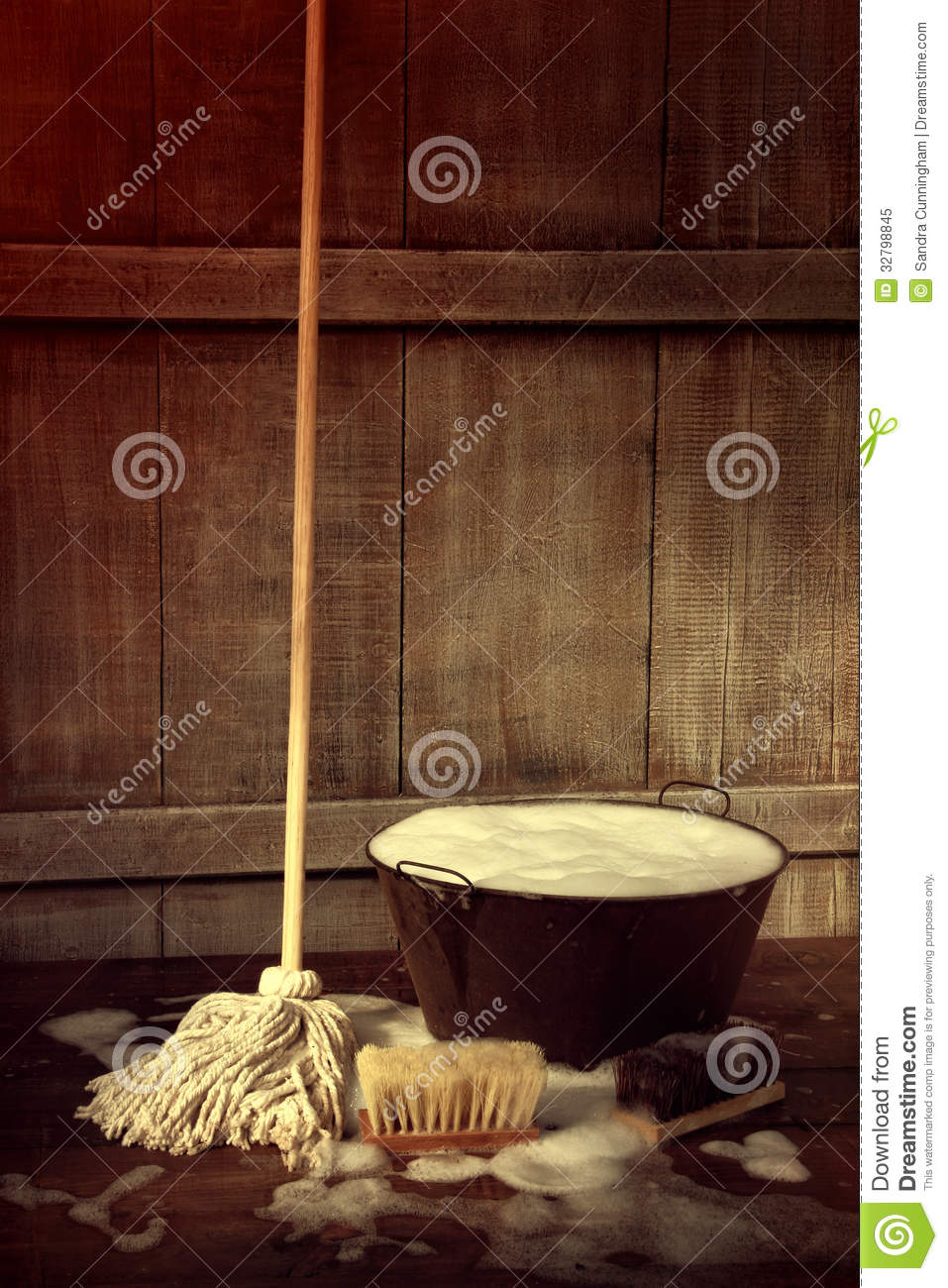 Mop And Bucket With Wet Soapy Floor Royalty Free Stock