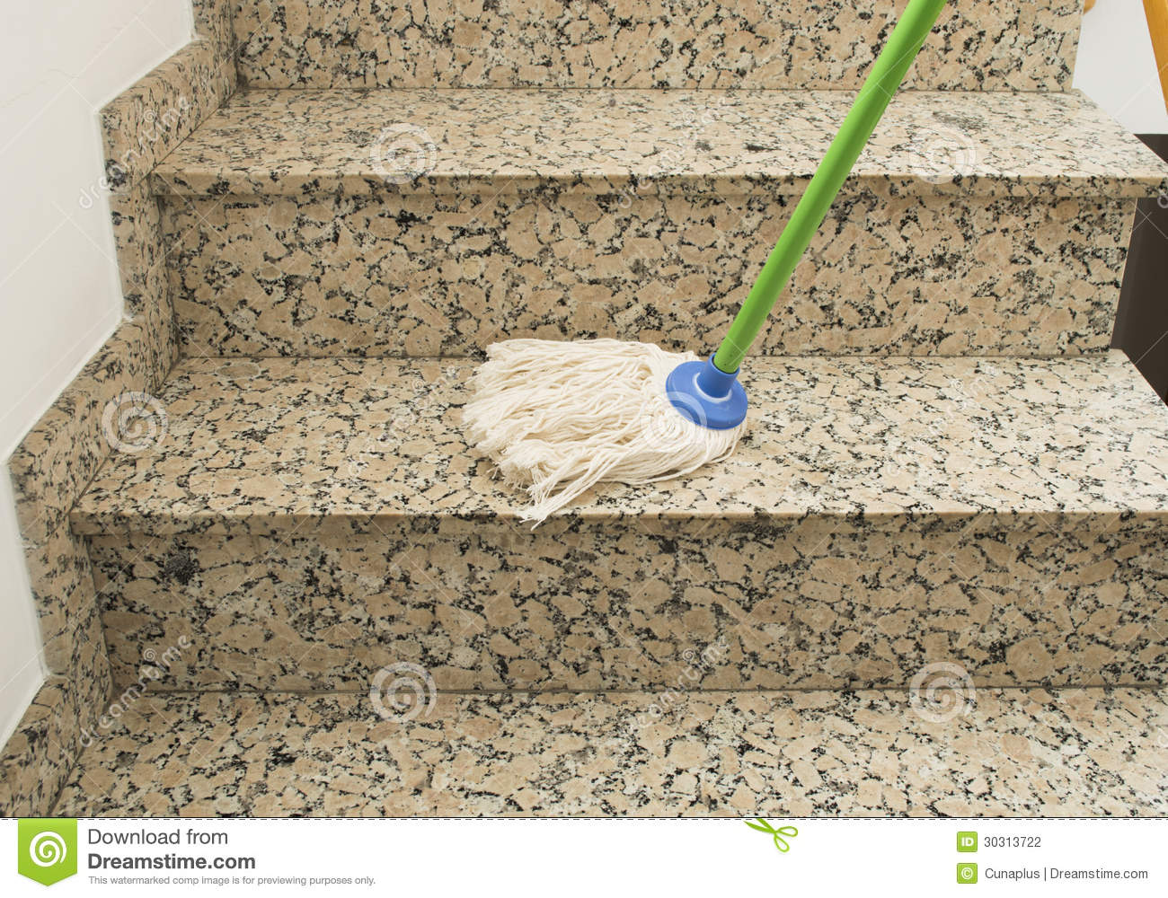 cleaning the stairs marble with mop stock photography