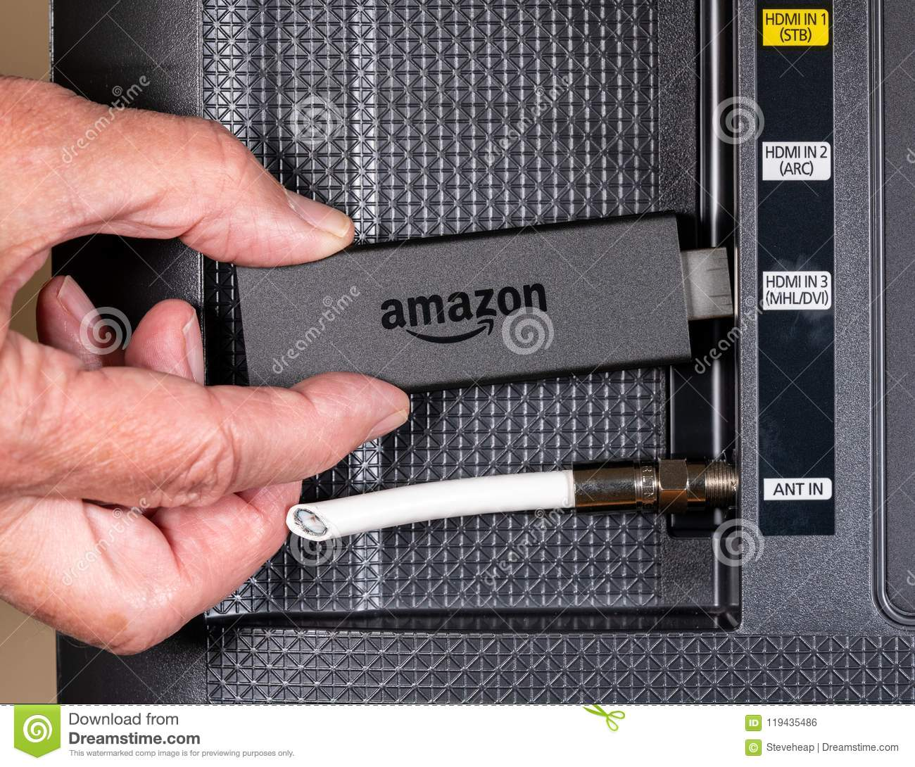 Senior Man Hand Inserting Amazon Fire TV Device Editorial