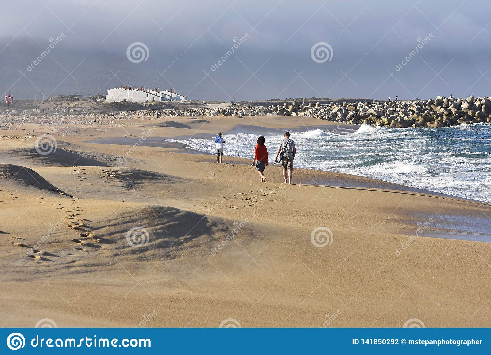 Morning beach walk Nazare Portugal