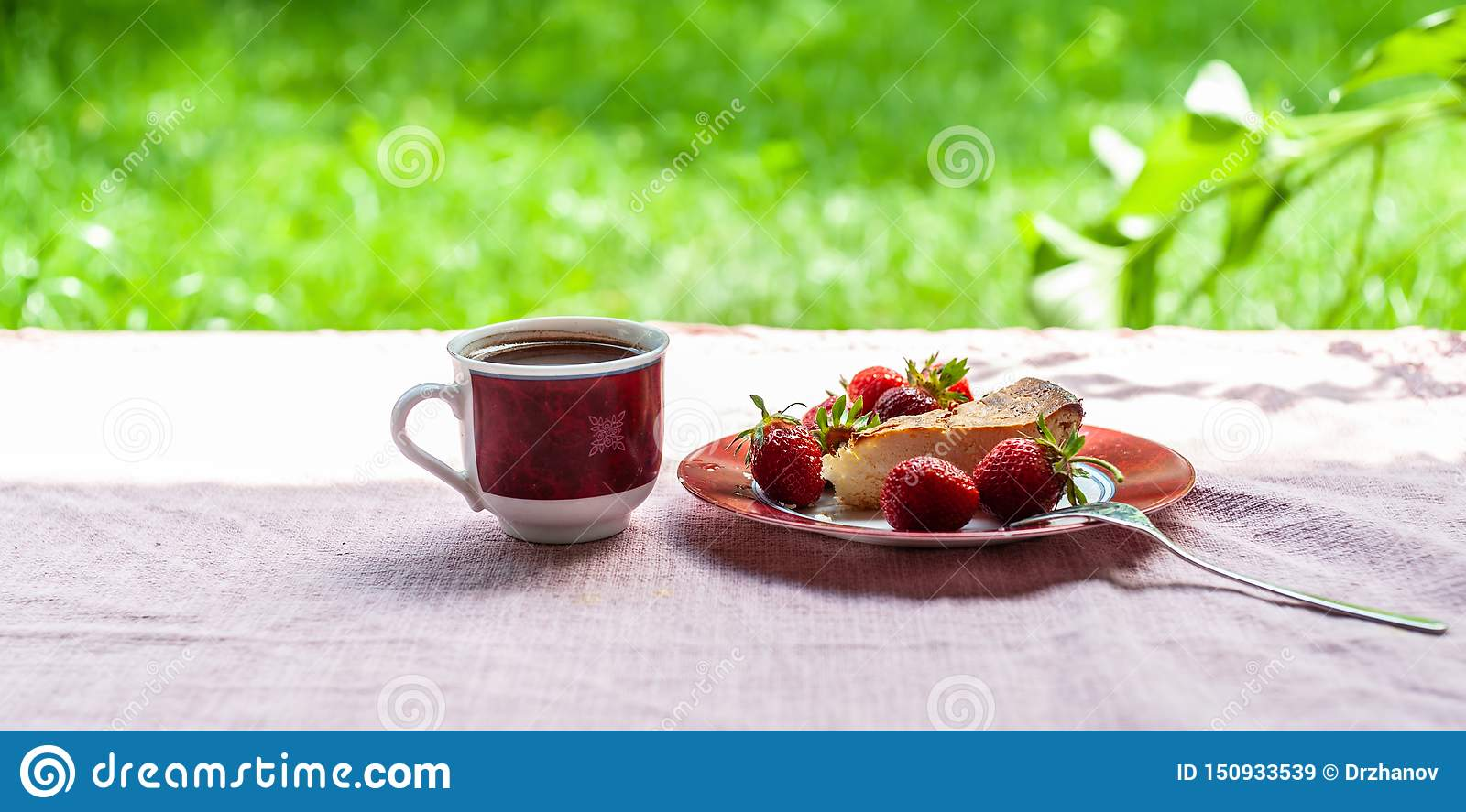 Morning breakfast as of cheese cake, several strawberries on simple plate and 1 white-red cup of coffee on the soft pink
