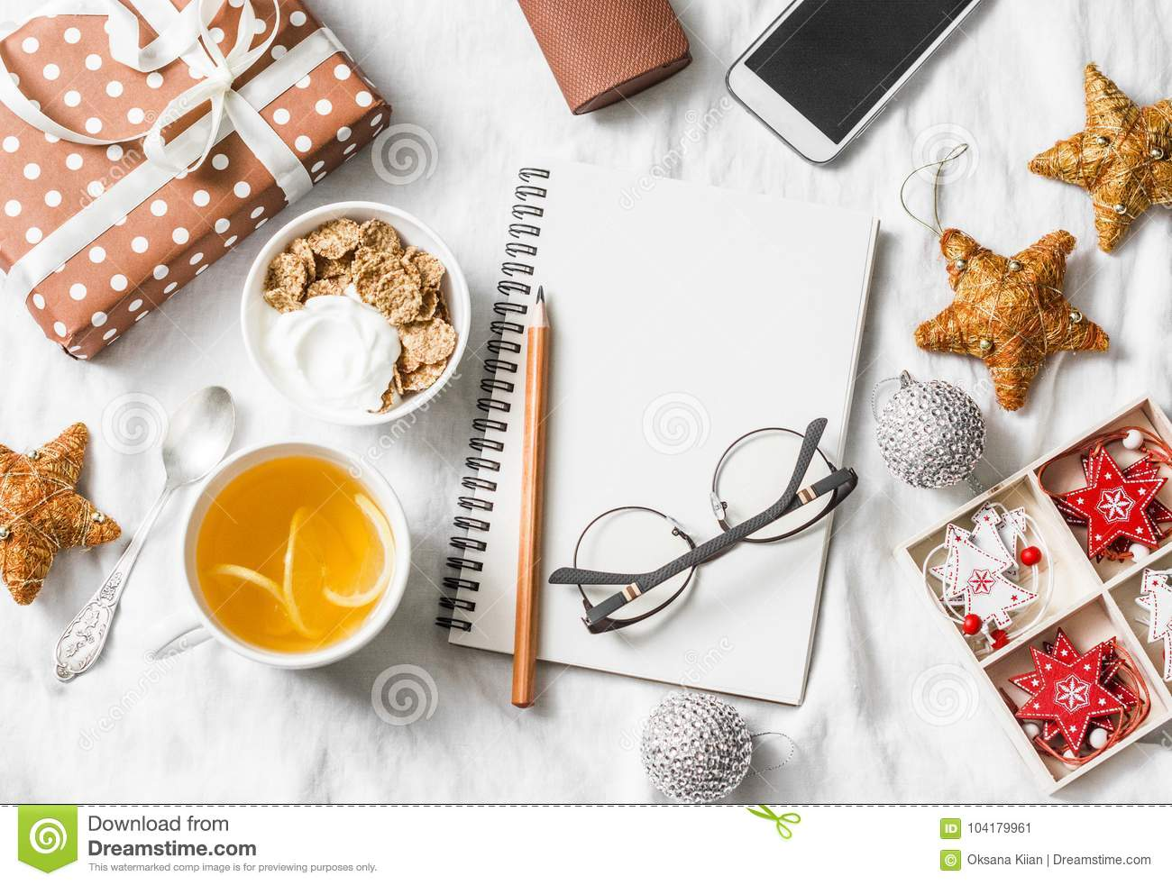 Morning breakfast christmas inspiration planning concept. Yoghurt with whole grain cereal and tea with lemon, christmas decoration