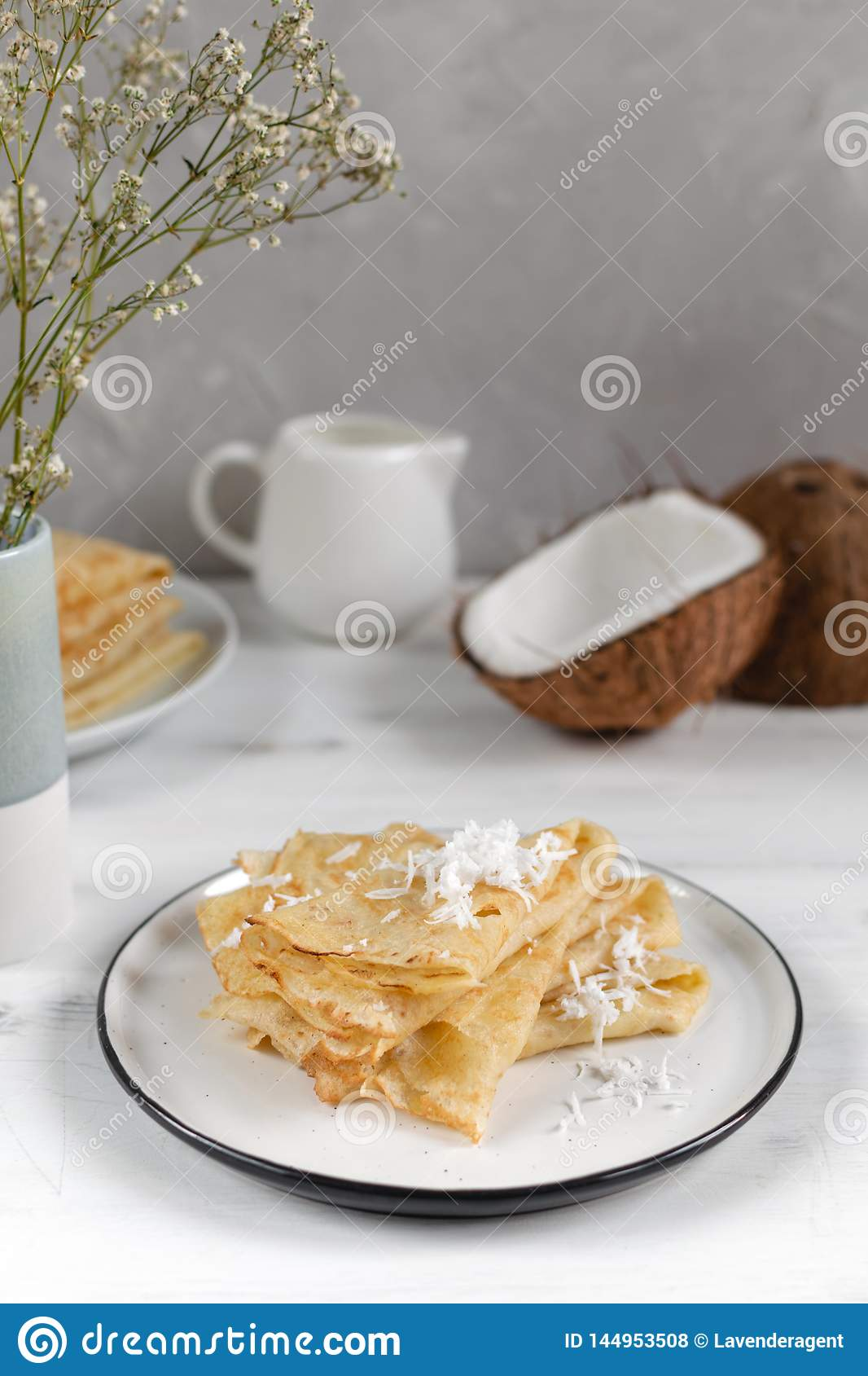 Morning, breakfast - traditional russian blini pancakes, french crepes, fresh coconut, milk bottle, white ceramic pitcher