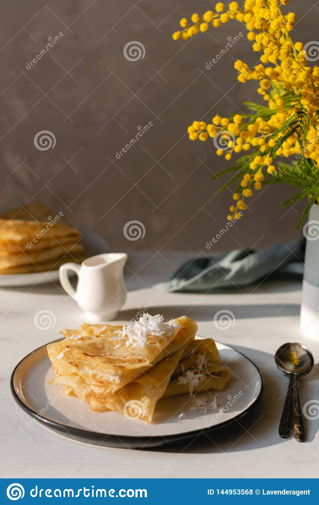 Morning, breakfast - traditional russian blini pancakes, french crepes whipped cream, mimosa flower