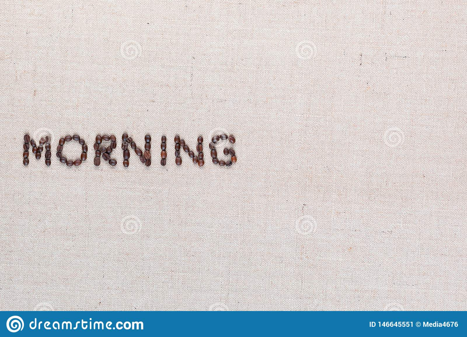 Morning letter sign from coffee beans isolated on linea texture, aligned middle left