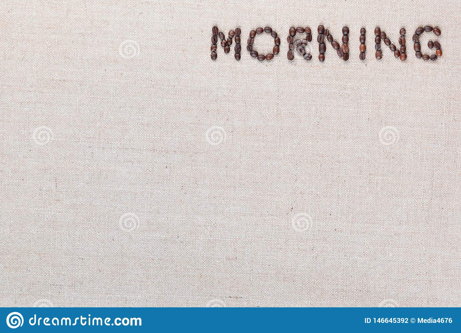 Morning letter sign from coffee beans isolated on linea texture, aligned top right