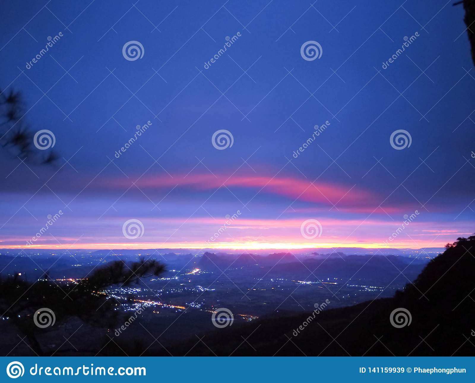 Morning light and colorful sky above mountain