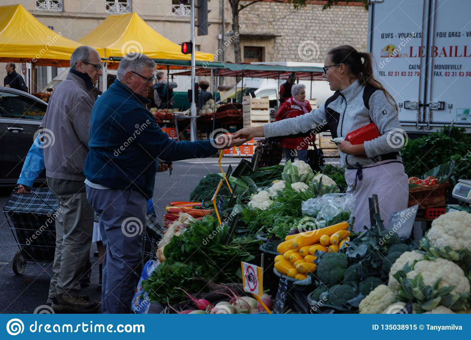 A morning street market in the city center with fresh farm vegetables