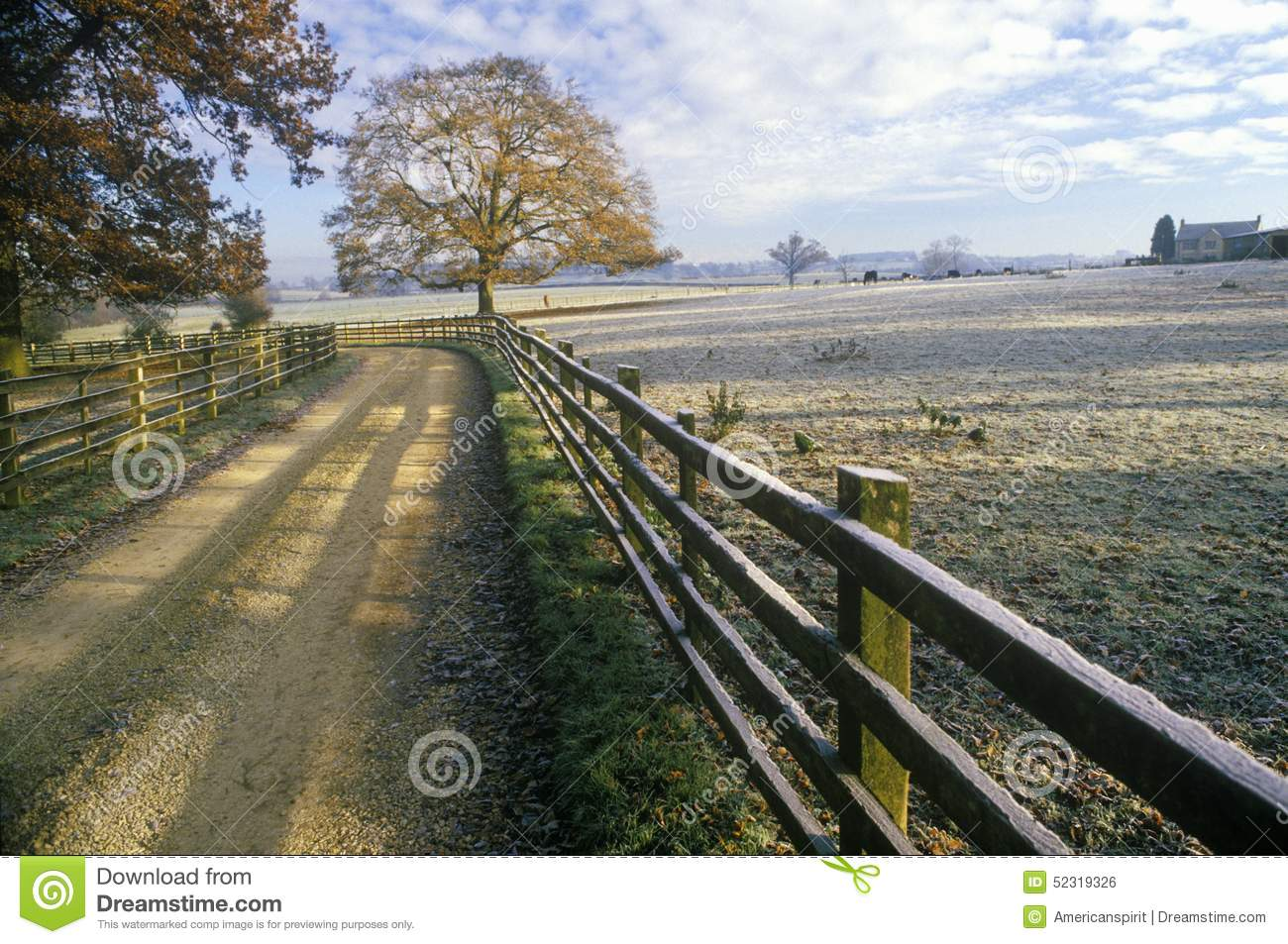 Morning view of a country road and wood fence in Upper Brails, England