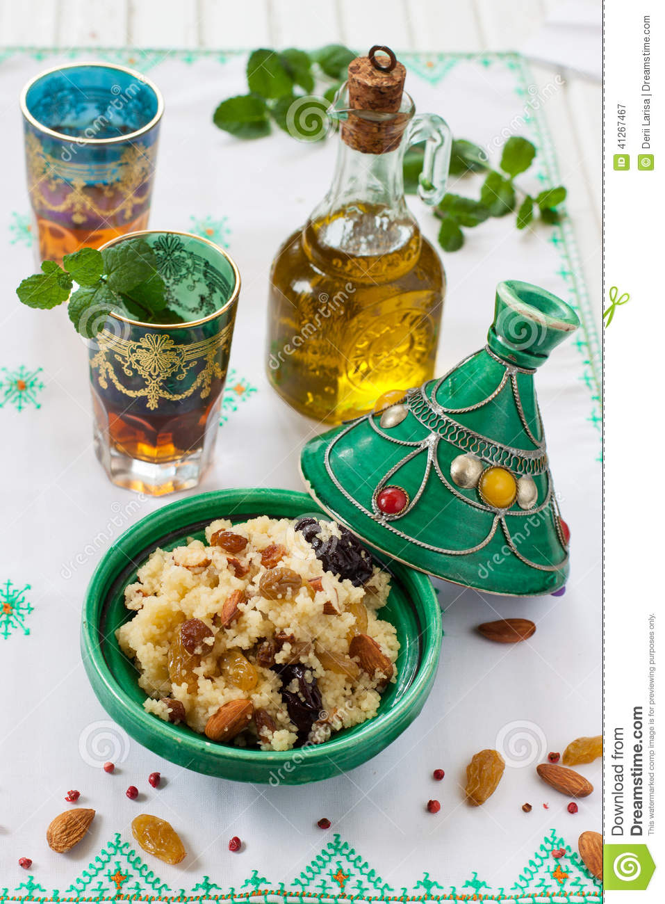 Moroccan Couscous With Dried Fruit And Nuts In A Tagine ...