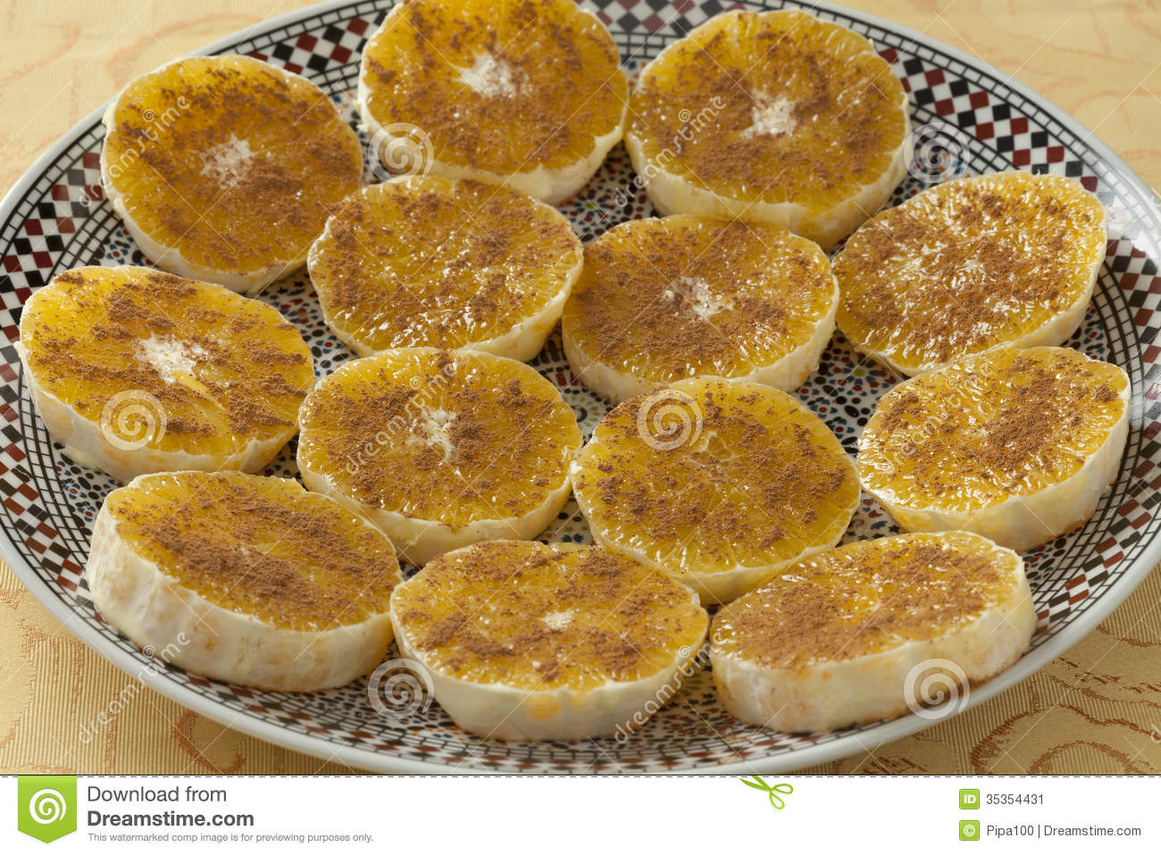 Traditional Moroccan orange slices with sugar and cinnamon as dessert.