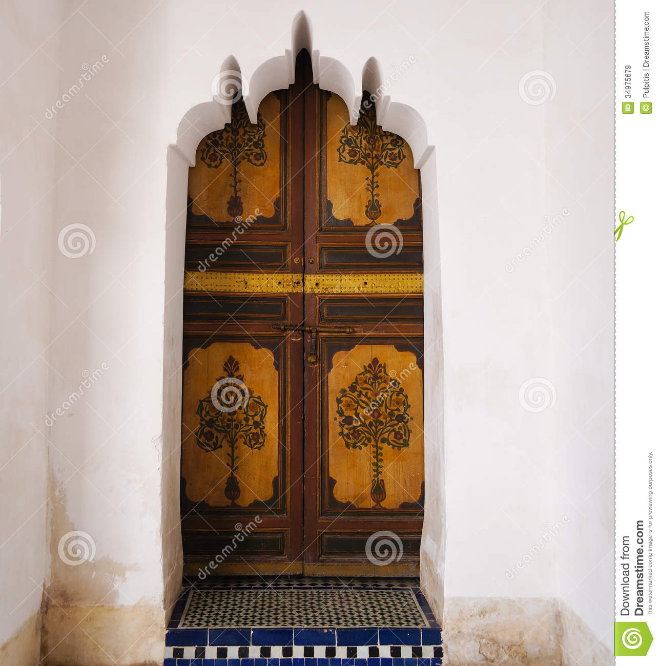 Moroccan Wooden Painted Door Set Inside A Carved Plaster