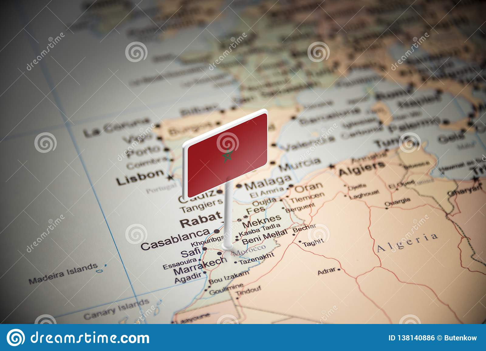 Morocco marked with a flag on the map