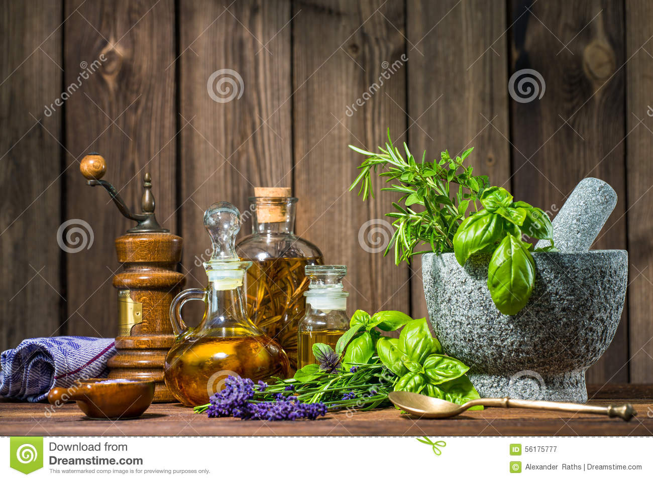 Mortar With Herbs And Oil On Wooden Table.. Full resolution  image, nominally Width 1300 Height 958 pixels, image with #81AF1C.