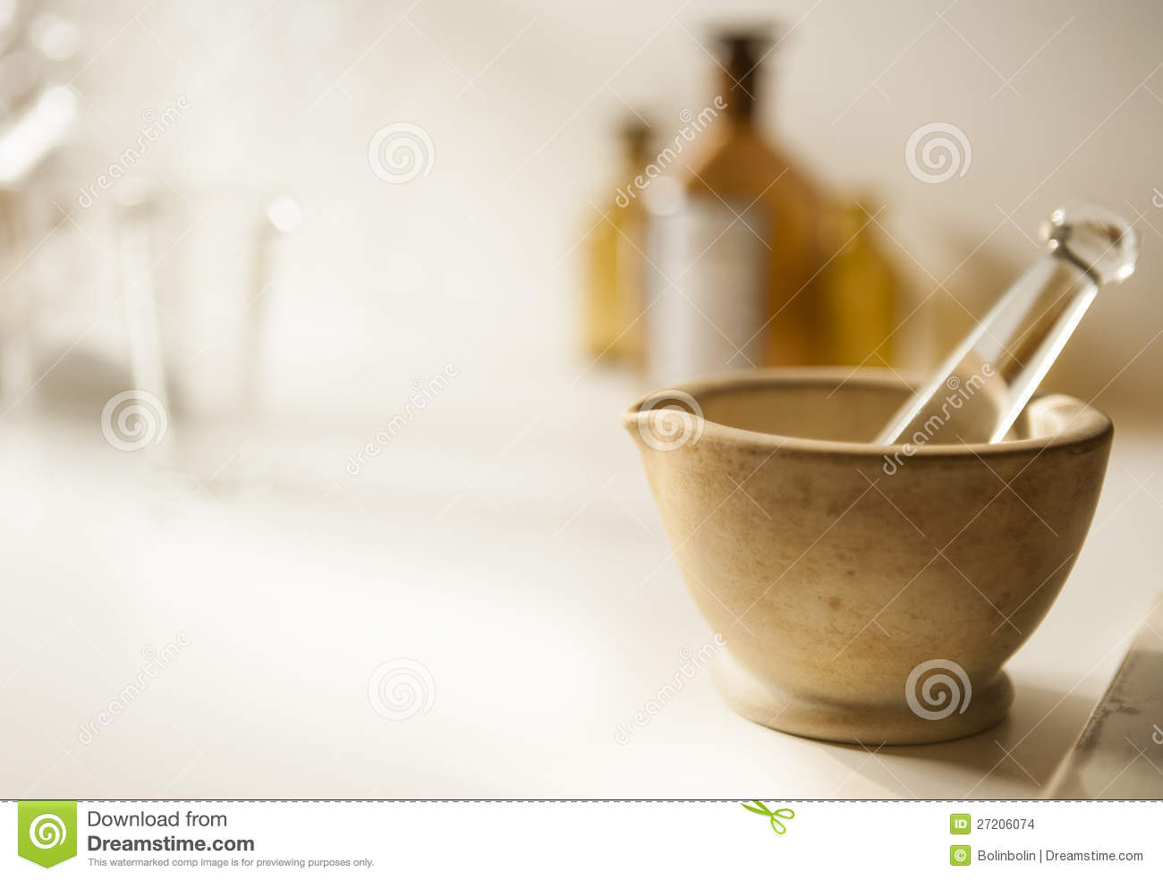 Mortar and pestle with drug vial and bottles
