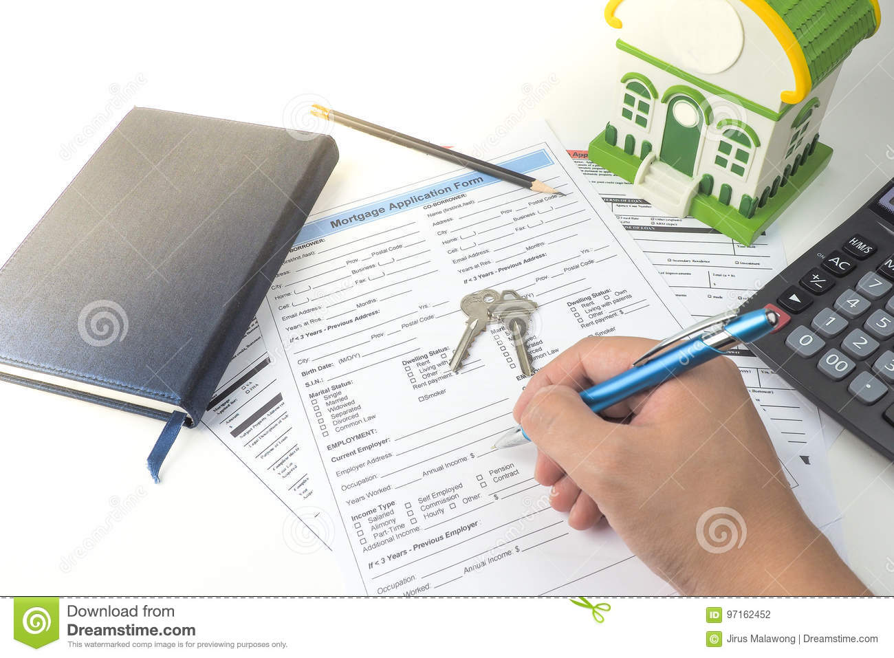 Mortgage application form, top view, house model, notebook.