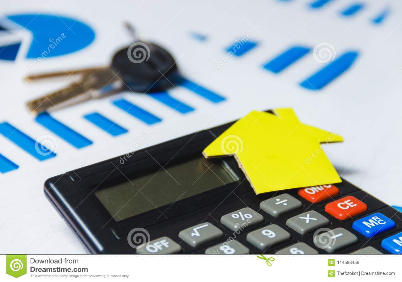 mortgage loans concept with key paper house and calculator on white