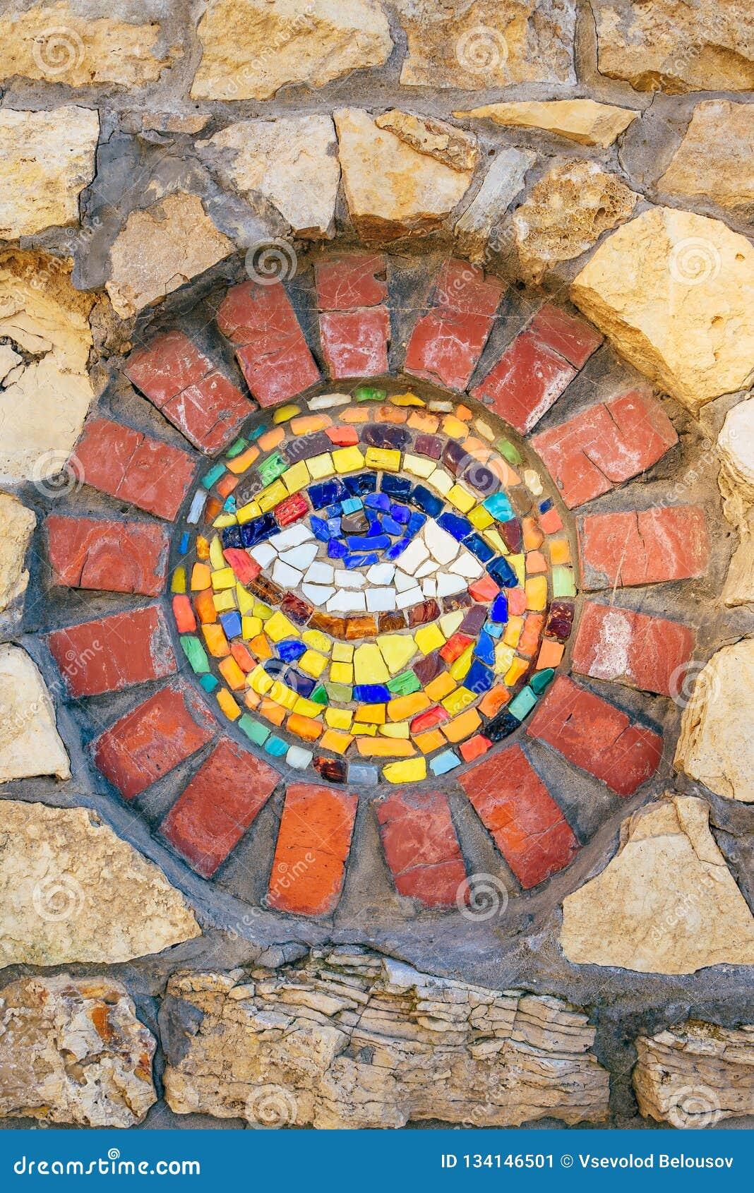 Mosaic Eye of Horus on stone wall