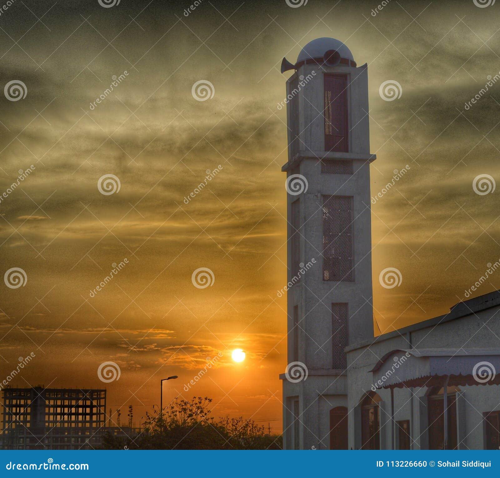 Moschee und Sonnenuntergang