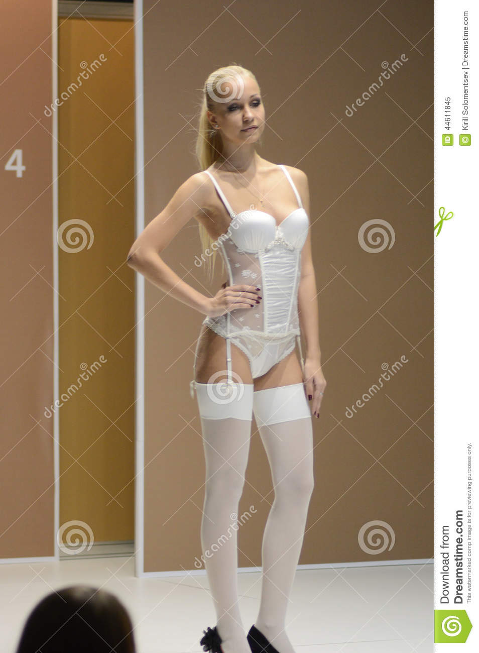 247ac4090 Moscow Lingrie Expo Fashion Show Young Woman In White Stockings And ...