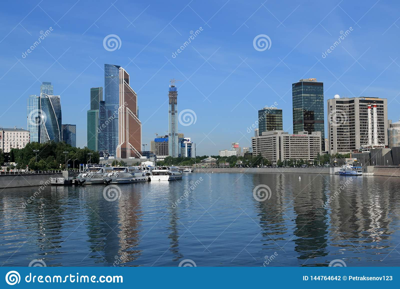 Moscow, Russia - June 16, 2018: Moscow summer cityscape with river and high-rise buildings