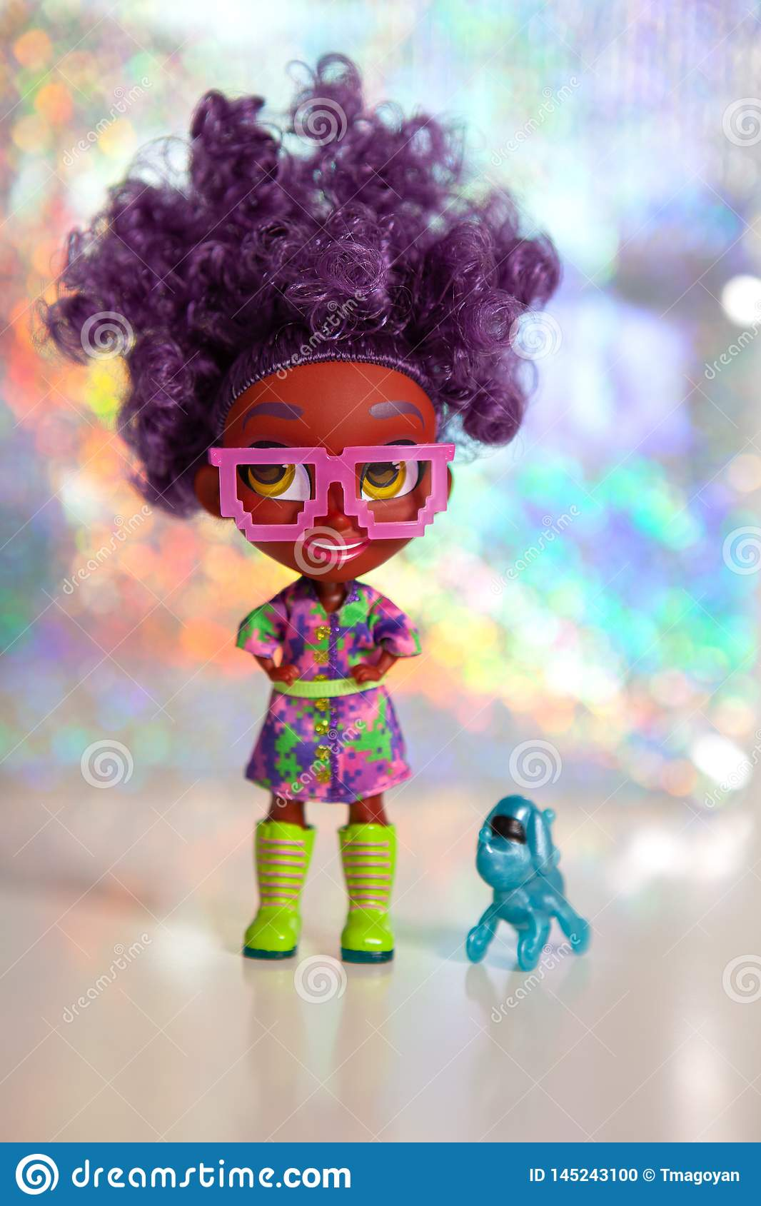 Moscow, Russia - April 18, 2019: Doll surprise Hairdorables. Series 1. Dark-skinned doll with glasses with thick curly hair.