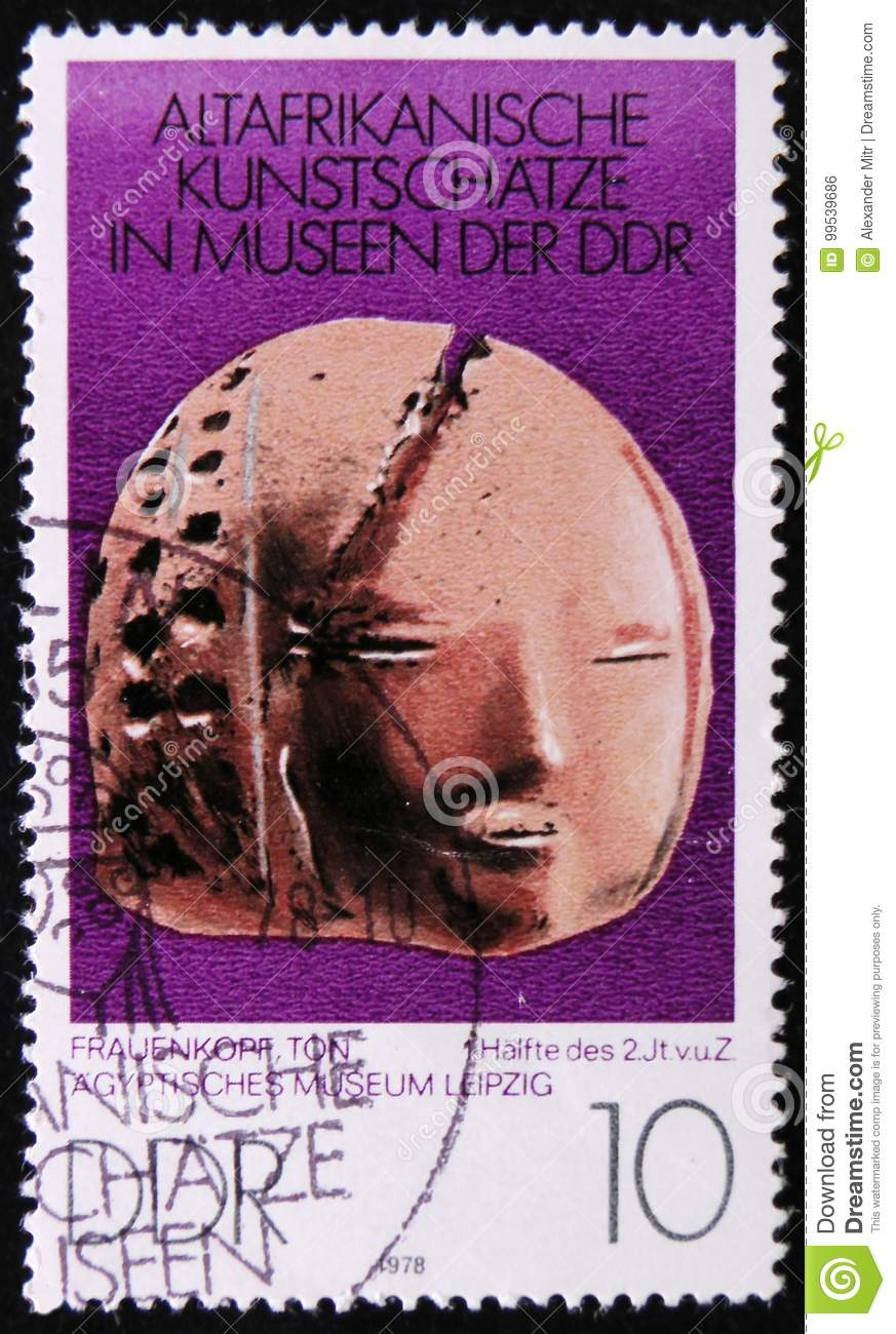 MOSCOW, RUSSIA - APRIL 2, 2017: A post stamp printed in DDR (germany) shows a ceramic doll face, the series  Old African Art