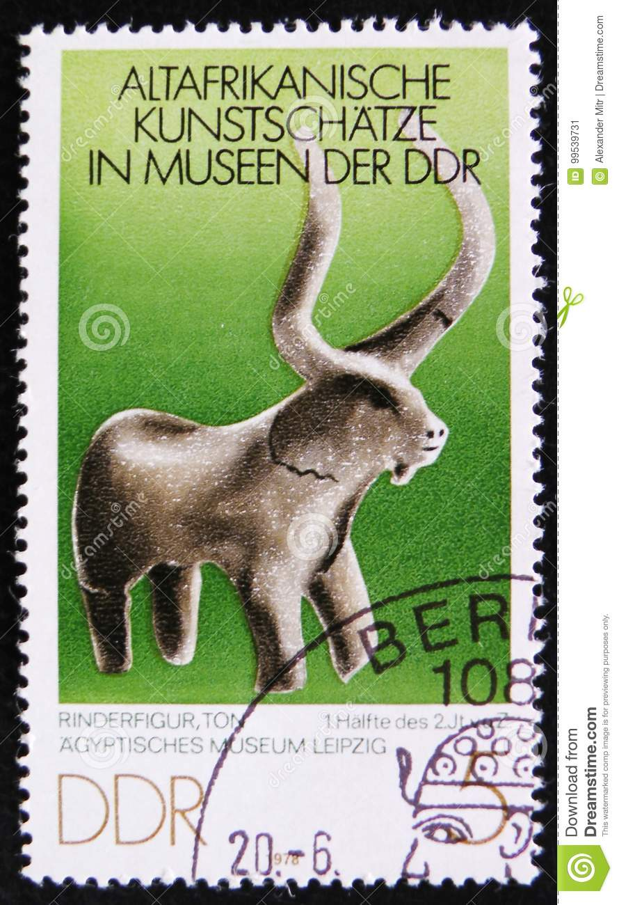 MOSCOW, RUSSIA - APRIL 2, 2017: A post stamp printed in DDR (germany) shows a stone figure of bull, the series  Old African Art T
