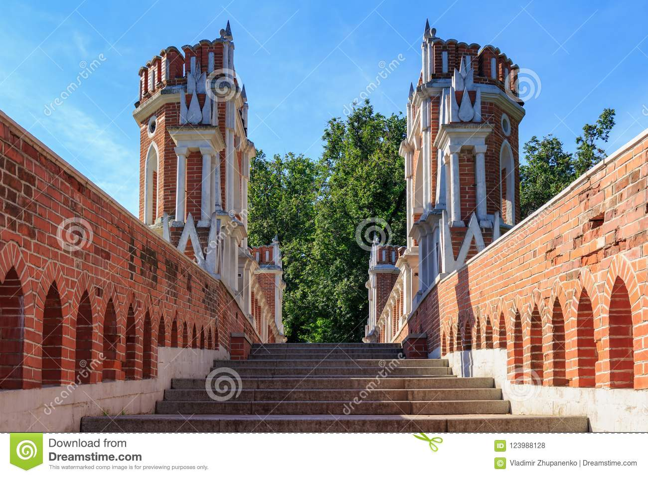 Moscow, Russia - August 12, 2018: Steps and towers of Figured bridge in Museum-reserve Tsaritsyno closeup on a blue sky background