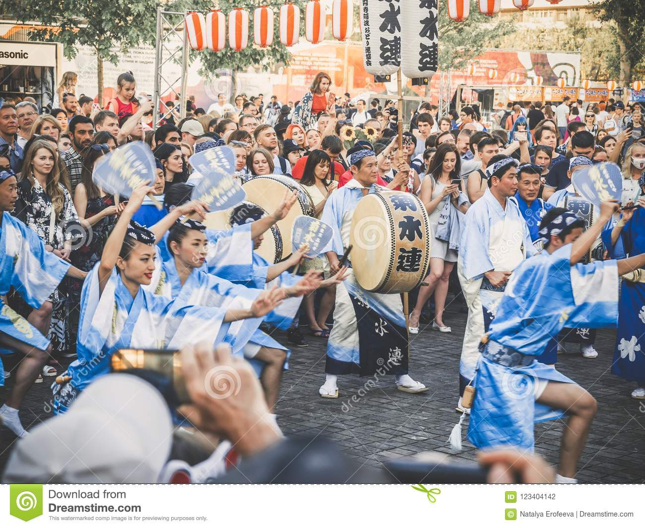 Moscow, Russia - August 09, 2018: Traditional japenese Awa Dance. Dancers perform the Bon Odori dance, musicians in blue