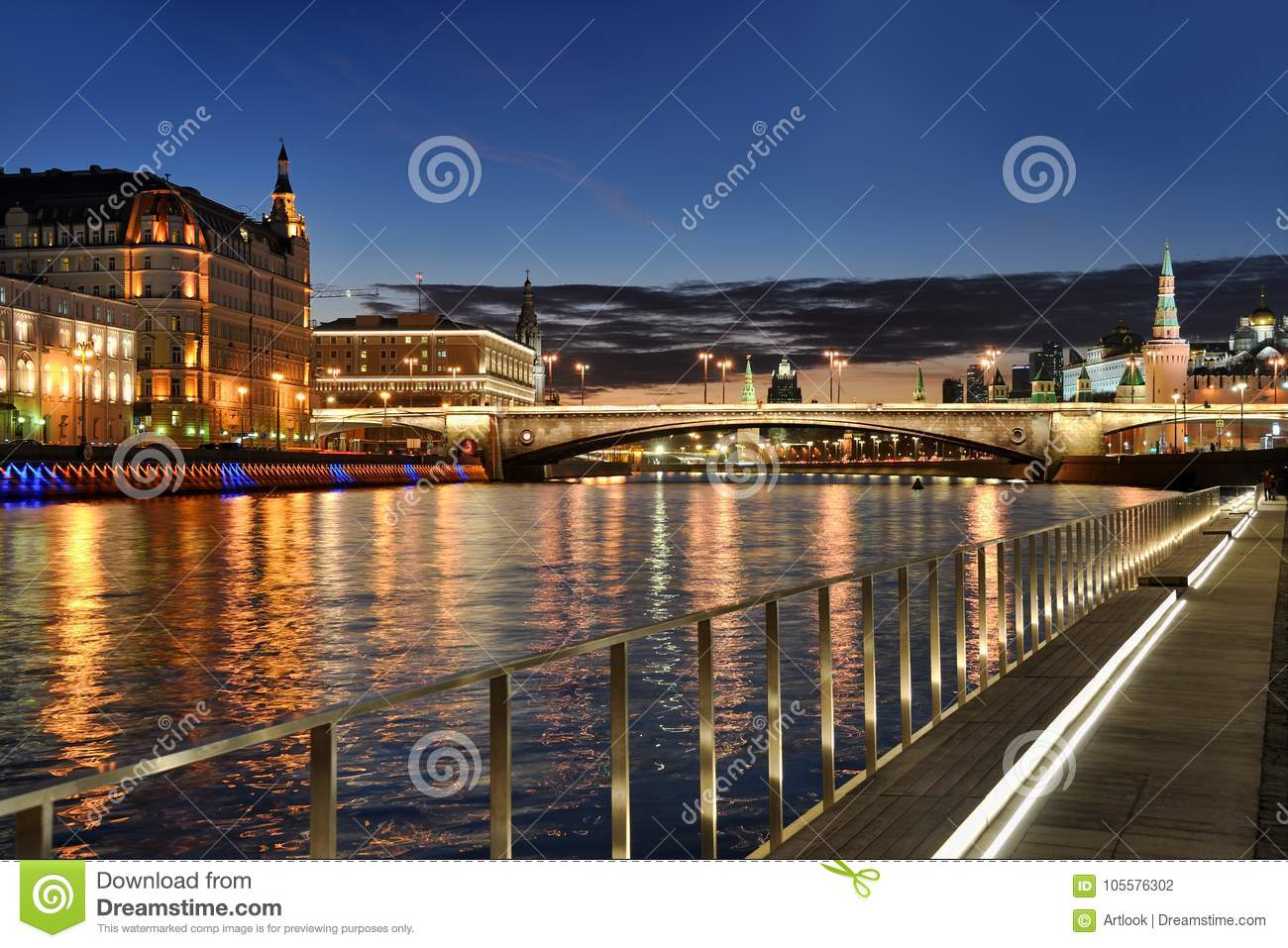 Moscow City Lights with River Reflections Against Dusk Sky