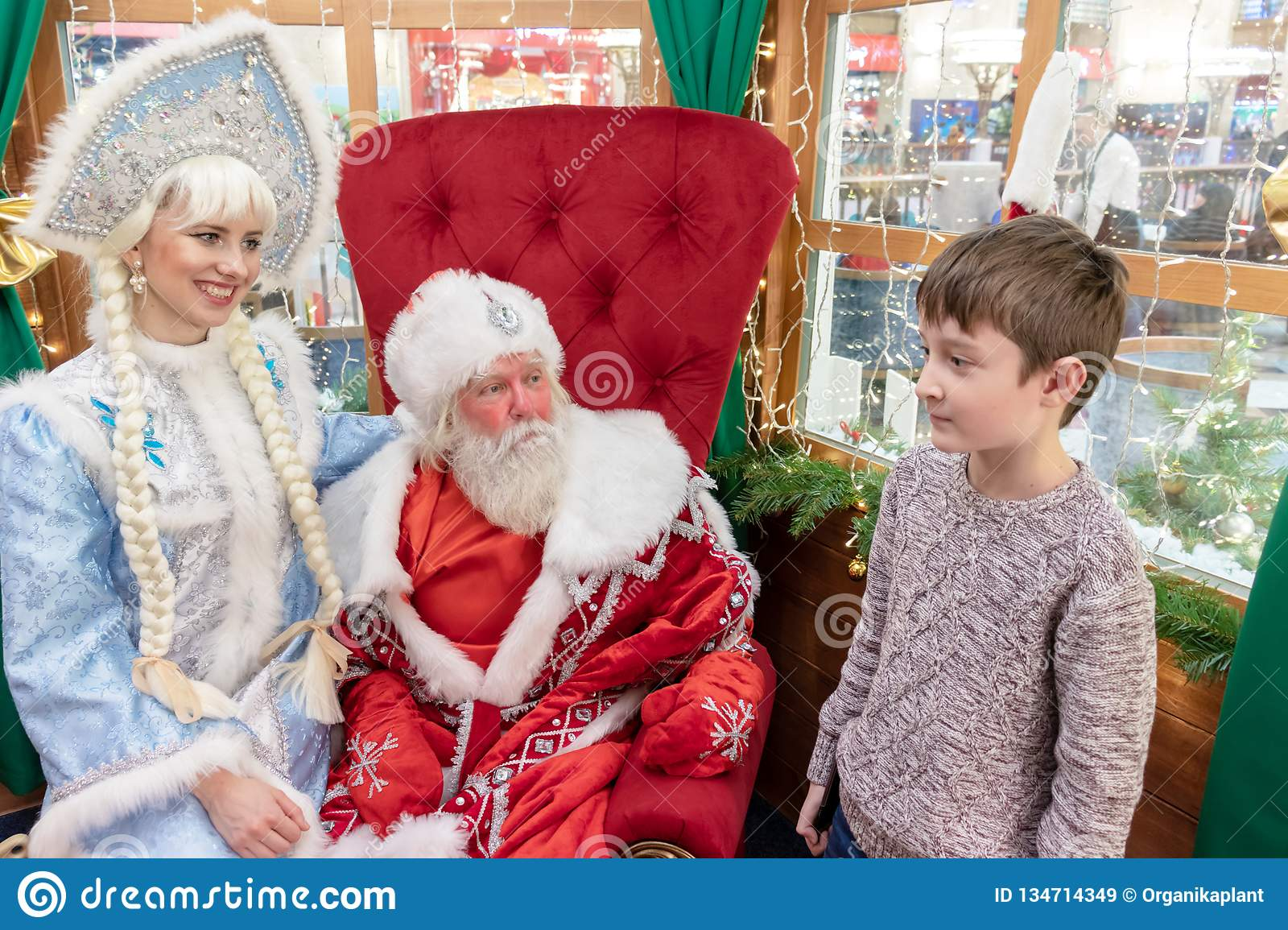 MOSCOW, RUSSIA - DECEMBER 1, 2018: A boy meets Santa in his house in Central Children`s Shop, New Year and Christmas eve