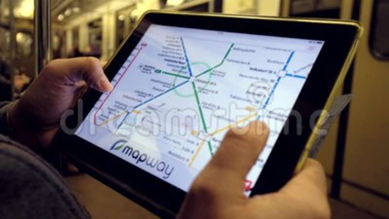 Man Looking At Subway Map.Man In Underground Examines The Subway Map Using The Tablet Searching Railway