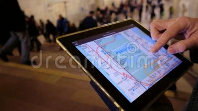 Man Looking At Subway Map.Man In Underground Examines The Subway Map Using The Tablet Searching Pointing