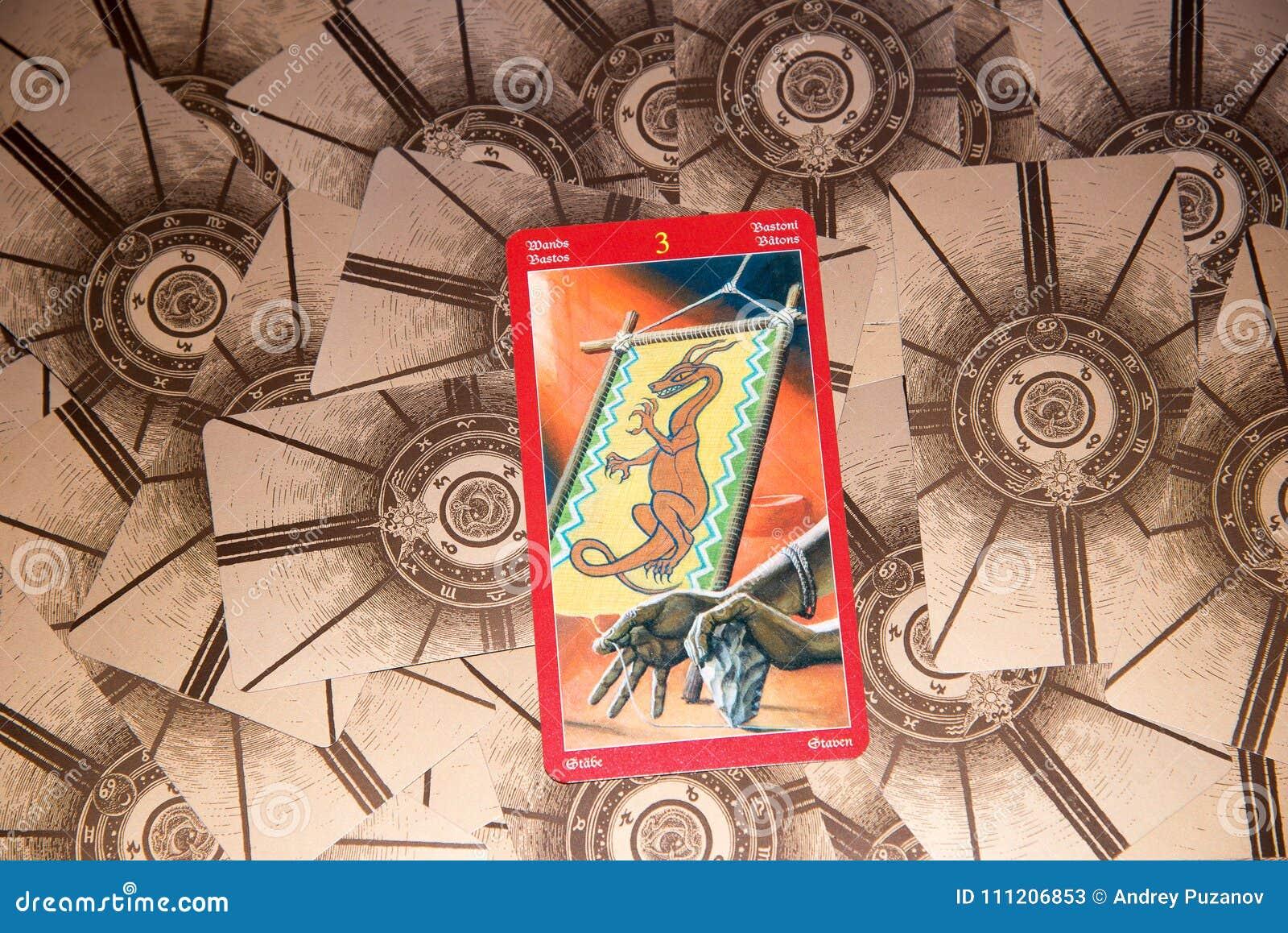 Tarot card Three of Wands. Dragon tarot deck. Esoteric background.