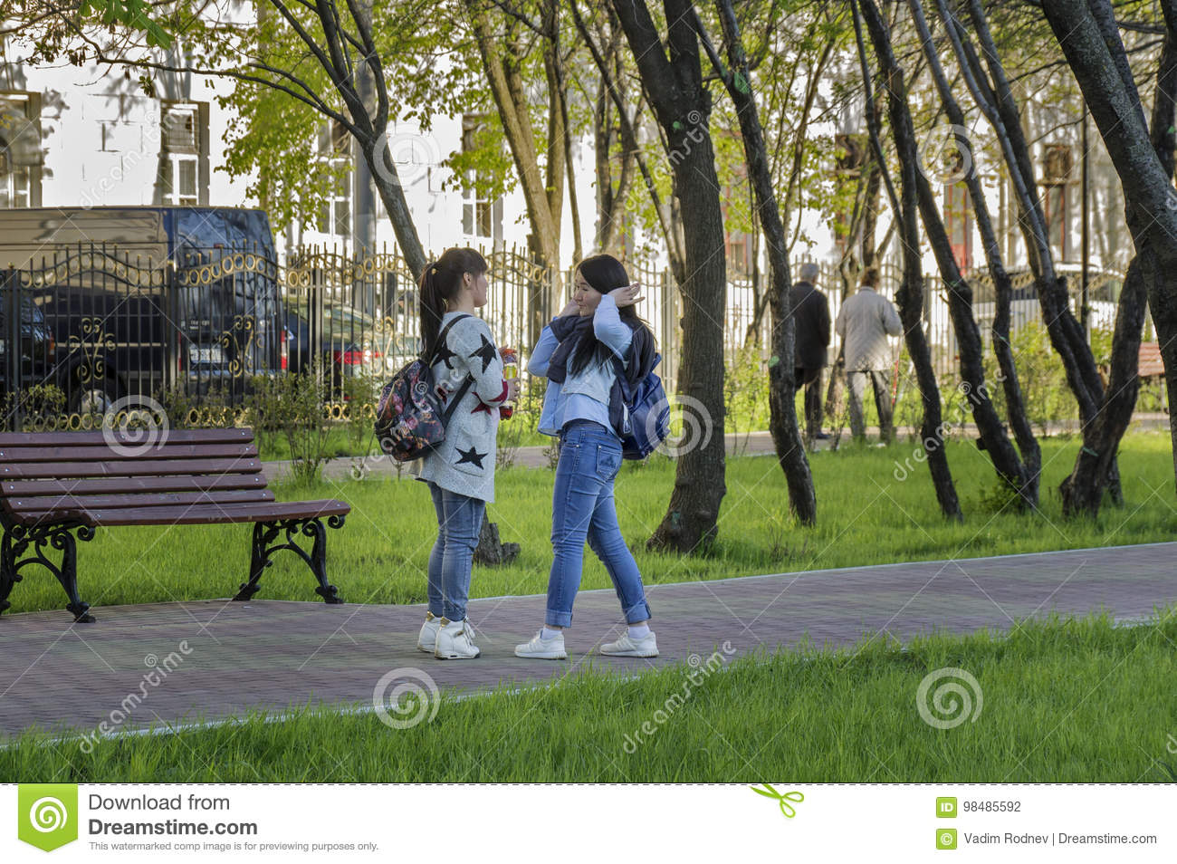 MOSCOW, RUSSIA - 2017-05-14: Girls having a lively talk in the Warriors-Winners Park in Lefortovo neighborhood.