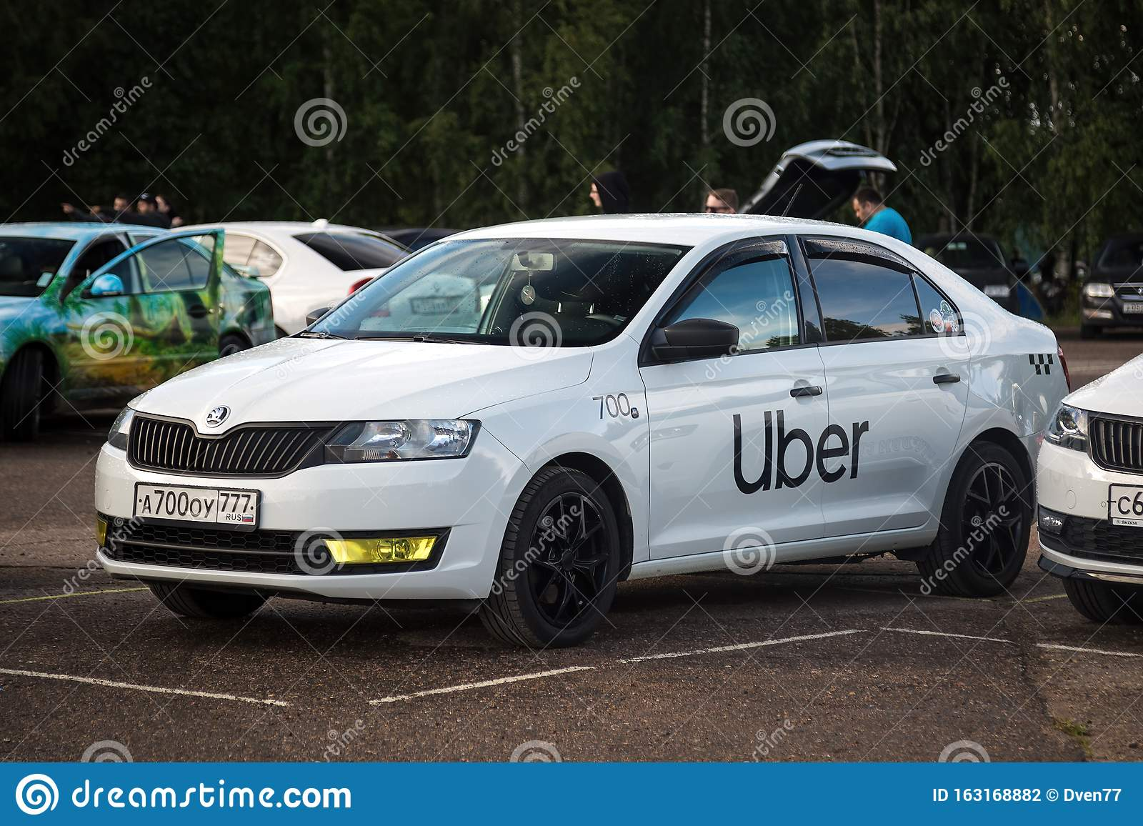 Moscow Russia July 06 2019 Skoda Car Of White Color Taxi Uber Is Standing In The Parking Lot Editorial Photography Image Of Logo Skoda 163168882