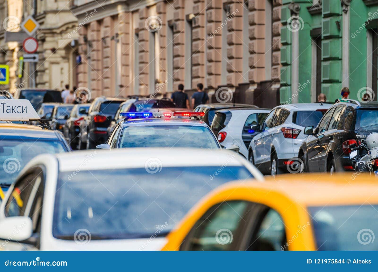 Cars parked on Ilinka street and police car