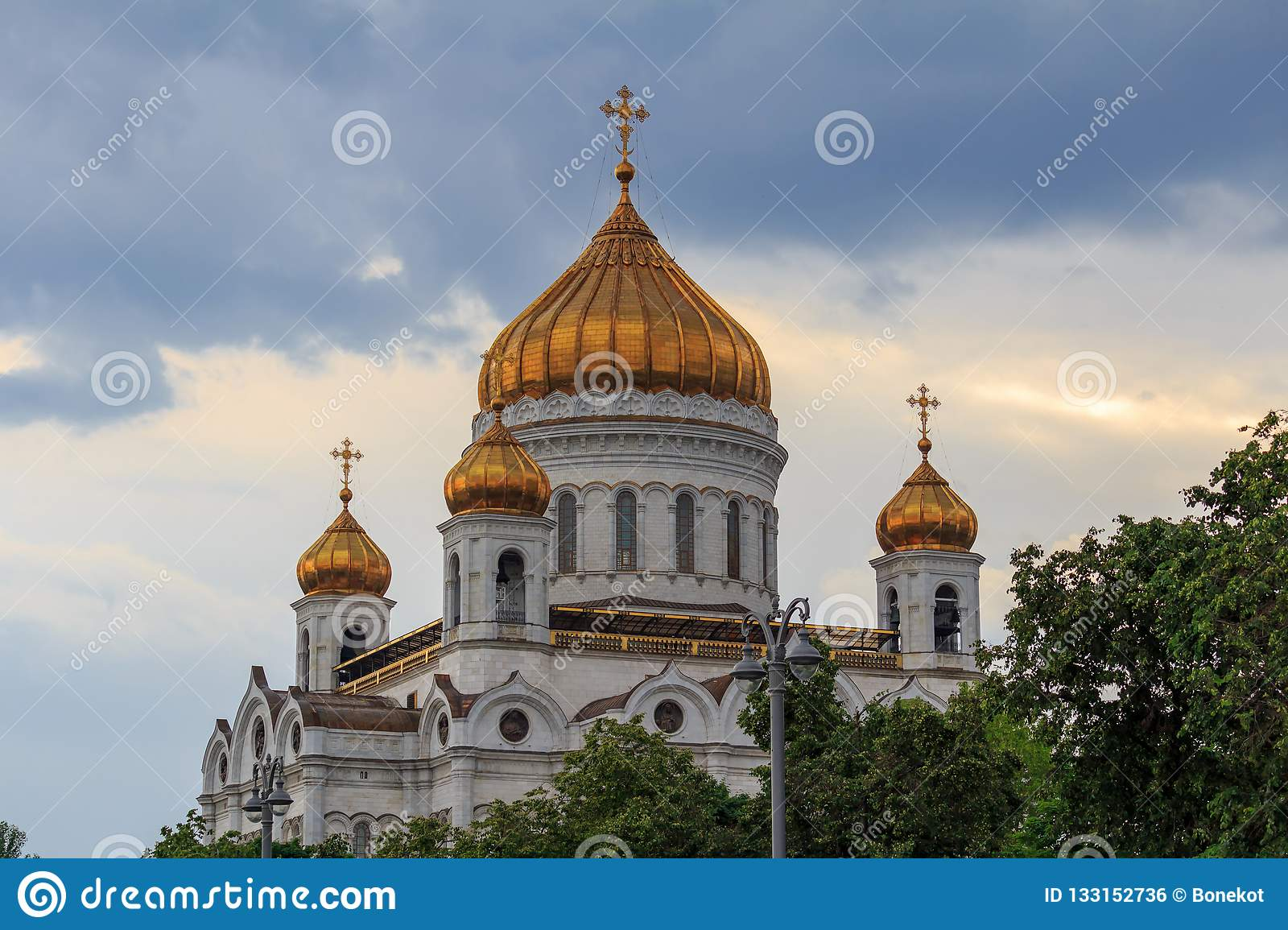 Moscow, Russia - June 19, 2018: Golden domes of Cathedral of Christ the Saviour in Moscow against dramatic sky