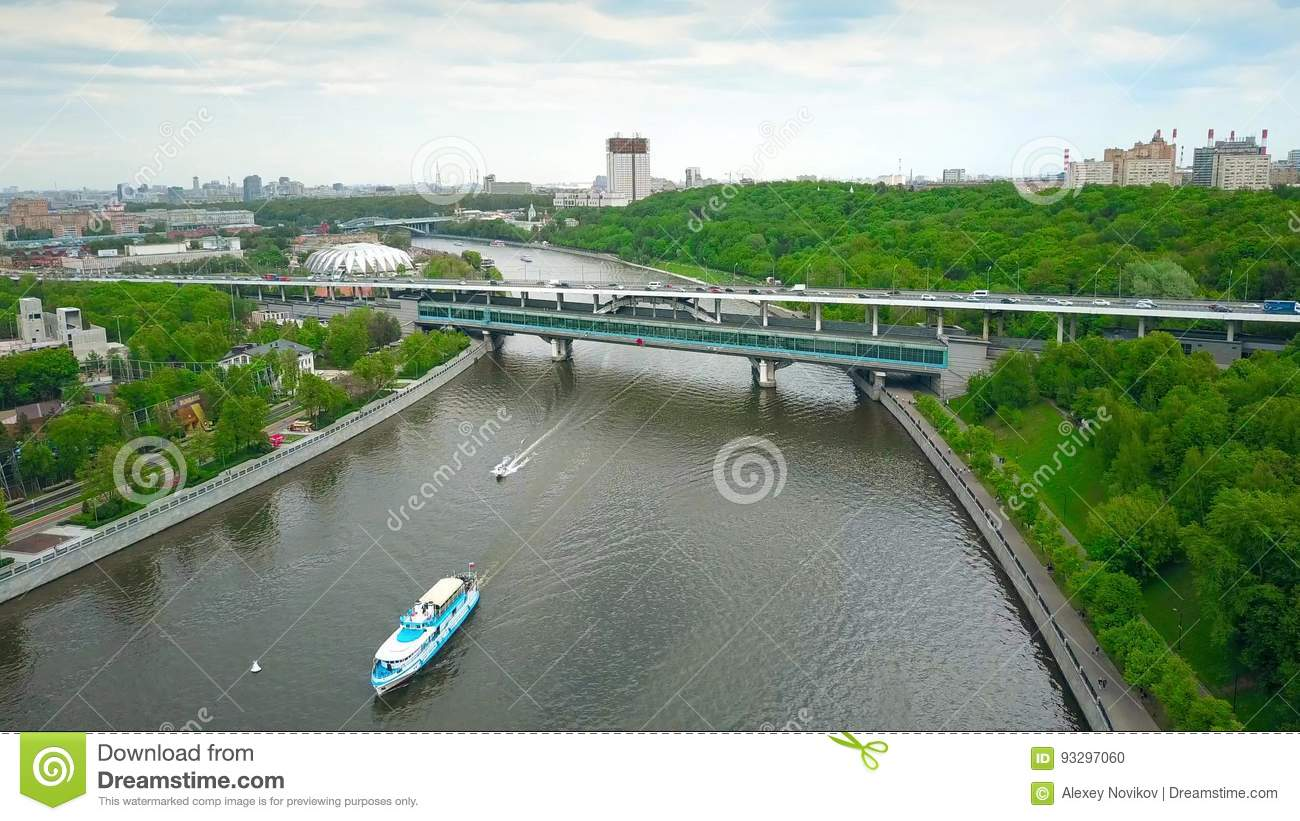 62ea8bee3c8f4 Aerial shot of Moscow river tour boats, cars and metro bridge and station  Vorobievy Gory