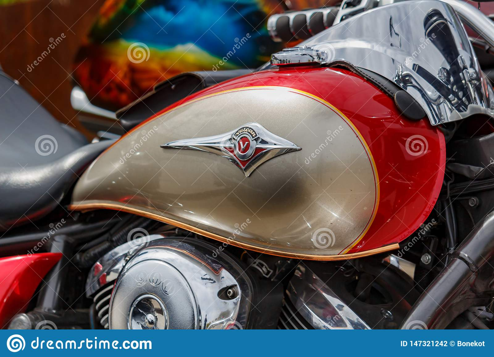 Moscow, Russia - May 04, 2019: Glossy red and bronze fuel tank of motorcycle with Kawasaki Vulcan emblem closeup. Moto festival