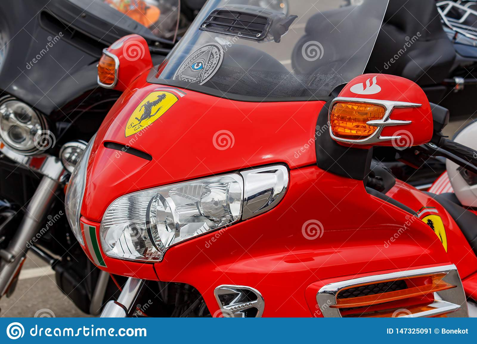 Moscow, Russia - May 04, 2019: Headlights in bright red windproof shield of tourist trike Honda Gold Wing closeup. Moto festival