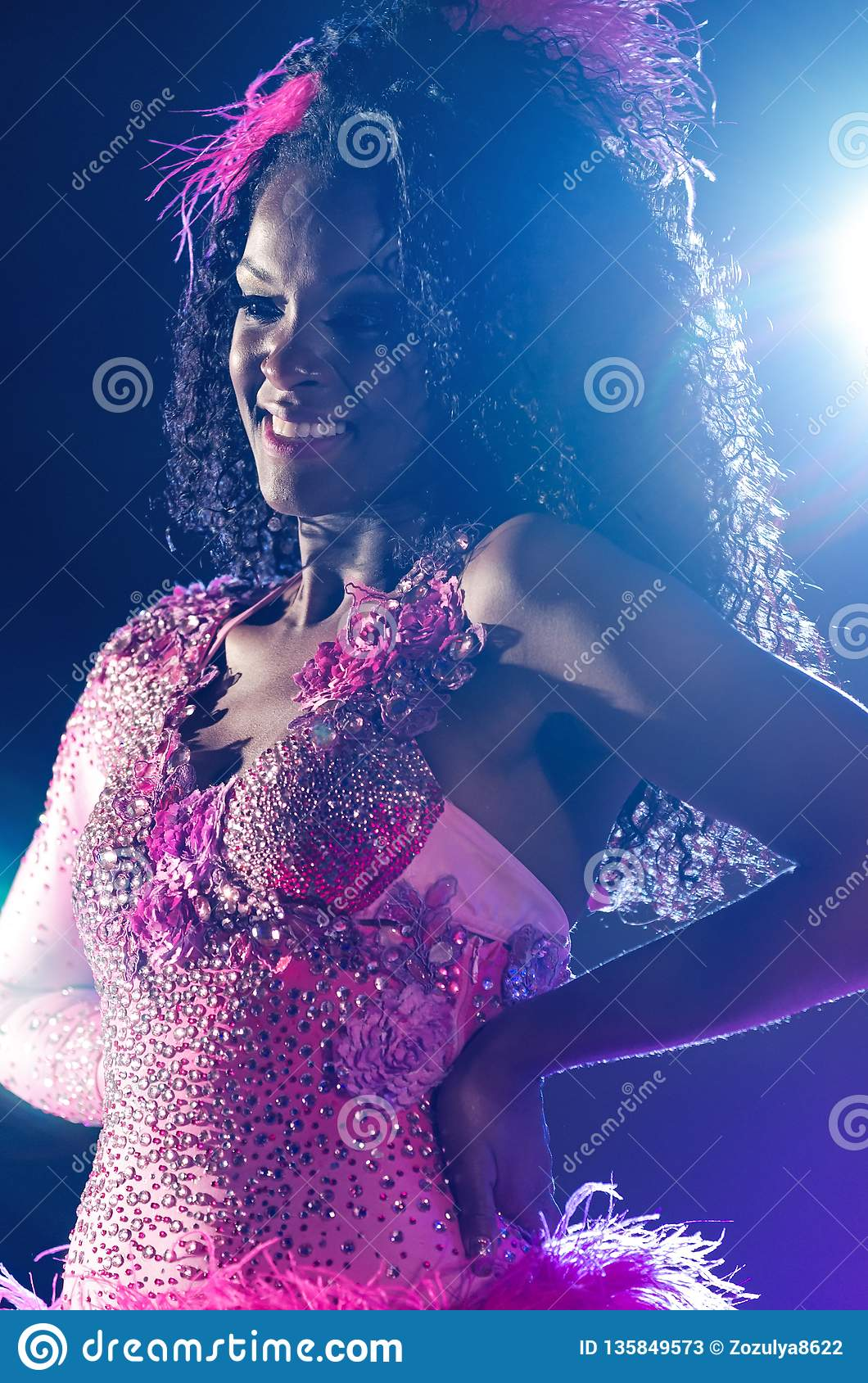 MOSCOW, RUSSIA- MAY 2017: Photo event with Beautiful girl bright carnival costume stage background. Portrait smiling